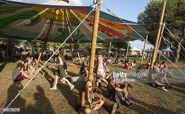 Revellers sit under a tent during the Rototom Sunsplash festival in Benicassim Castellon province on August 16 2014 Rototom runs from August 16 to 23...
