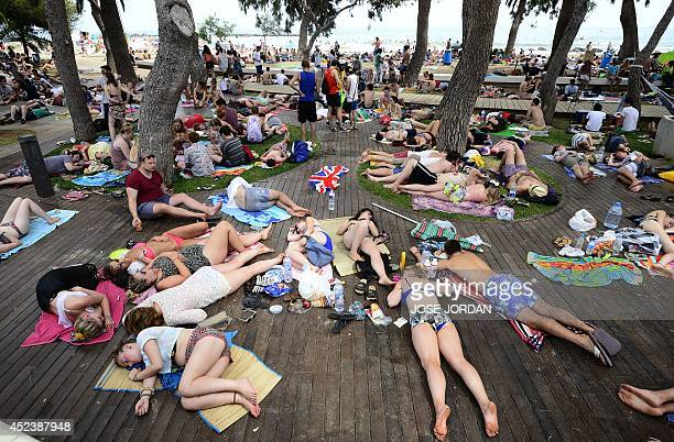Revellers sleep on a beach during the Benicassim International Festival in Benicassim Castellon province on July 19 2014 The FIB runs from July 17 to...