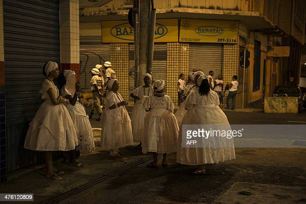 Revellers stand by during the street carnival in Salvador northeastern Brazil on March 2 2014 AFP PHOTO/HIROSUKE KITAMURA