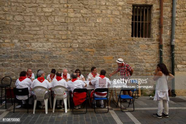 Revellers take gather for lunch in the street during the third day of the San Fermin Running of the Bulls festival on July 8 2017 in Pamplona Spain...