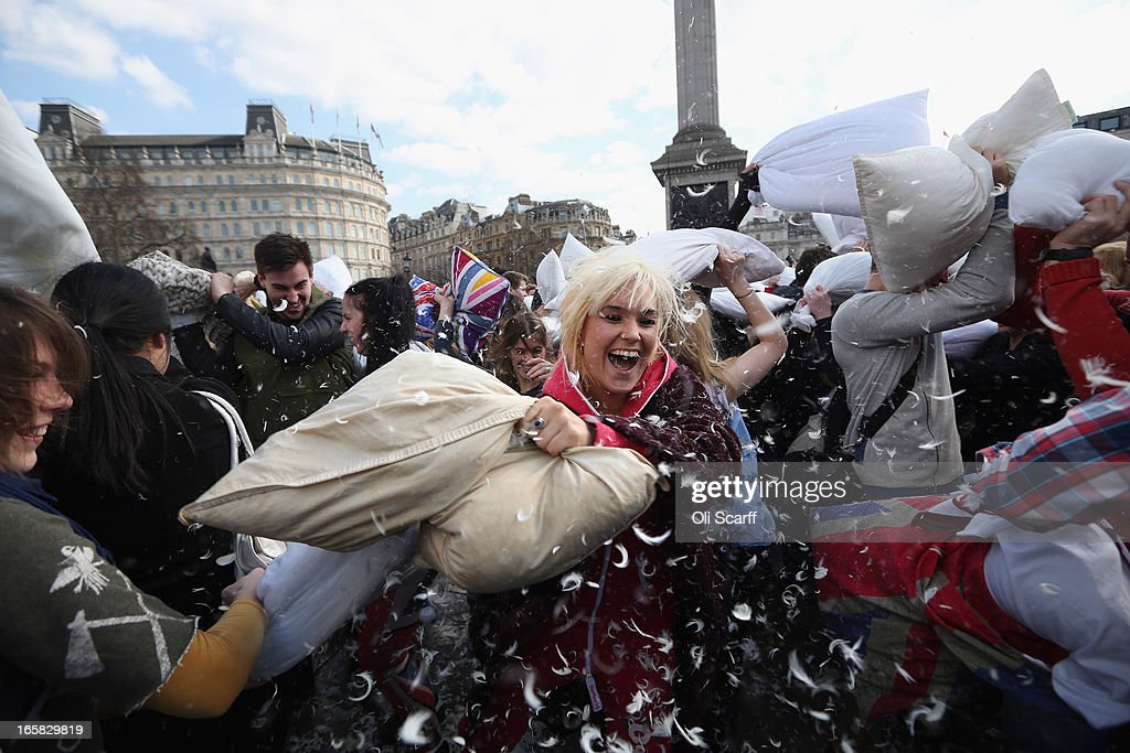 Revellers take part in a giant pillow fight in Trafalgar Square on 'International Pillow Fight Day' on April 6, 2013 in London, England. Mass public pillow fights have been arranged in numerous cities around the world as part of the 'Urban Playground Movement' which facilitates free, public non-commercial events.