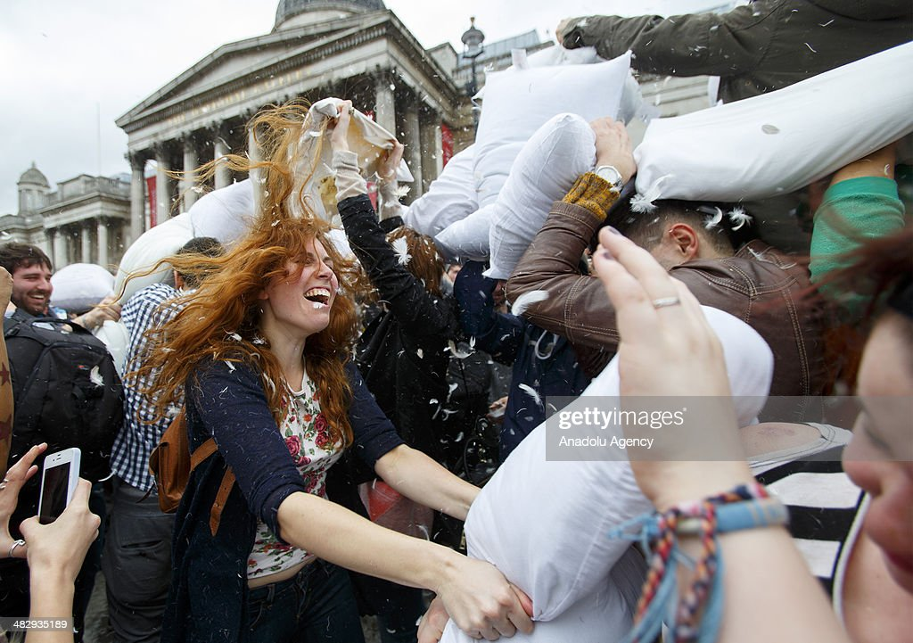 Revellers take part in a giant pillow fight in Trafalgar Square on 'International Pillow Fight Day' on April 5, 2014 in London, England. Mass public pillow fights have been arranged in numerous cities around the world by the 'Urban Playground Movement'.