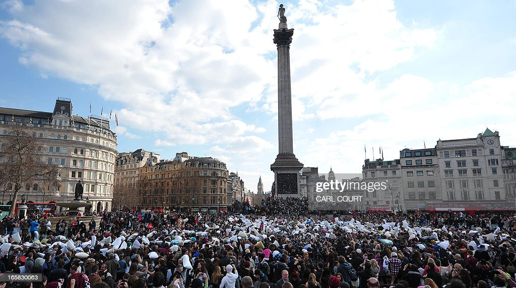 Revellers take part in a mass pillow fight in Trafalgar Square in central London on April 6, 2013 on International Pillow Fight Day. AFP PHOTO/CARL COURT