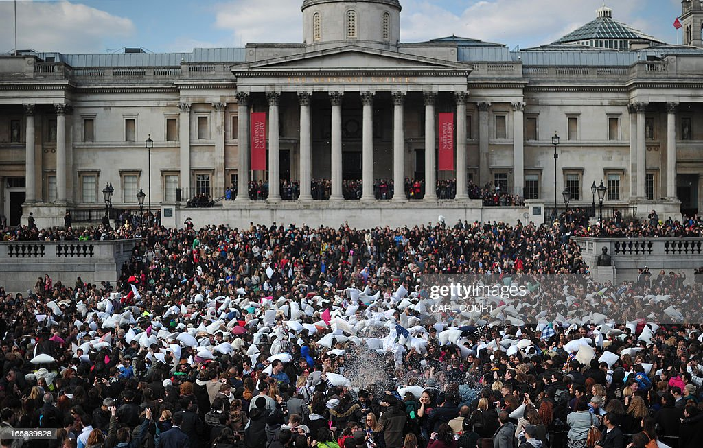 Revellers take part in a mass pillow fight in Trafalgar Square in central London on April 6, 2013 on International Pillow Fight Day.