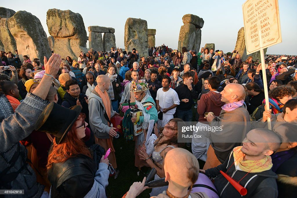 Revellers take part in celebrations to mark the summer solstice at Stonehenge prehistoric monument on June 21, 2014 in Wiltshire, England. An estimated 37,000 revellers and modern day druids gathered at Stonehenge, a tradition dating back thousands of years, to celebrate the solstice and watch the sunrise.