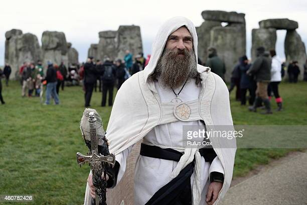 Revellers take part in celebrations to mark the winter solstice at Stonehenge prehistoric monument on December 22 2014 in Amesbury England About 1500...
