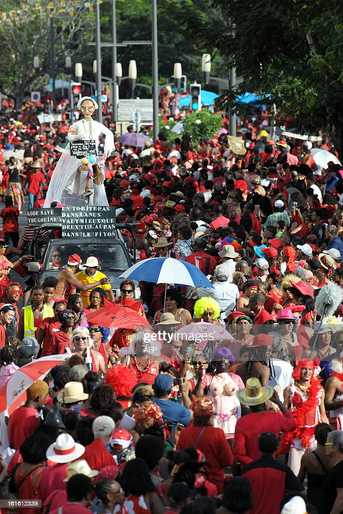 Revellers take part in Mardi Gras carnival parade on February 12, 2013 in Fort-de-France on the French Caribbean island of Martinique. The carnival started on February 9, 2013 and will run until Ash Wednesday on February 13, 2013 when Vaval, a giant papier-mache figure, symbolizing the king of the carnival, is burned.