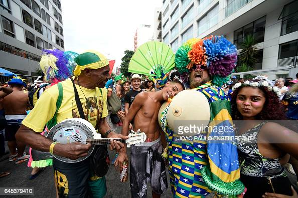 Revellers take part in the 'Banda de Ipanema' traditional carnival band parade in the beach of Ipanema in Rio de Janeiro Brazil on February 25 2017...