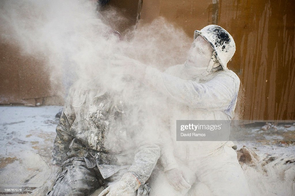 Revellers take part in the battle of 'Enfarinats', a flour fight in celebration of the Els Enfarinats festival on December 28, 2012 in Ibi, Spain. Citizens of Ibi annually celebrate the festival with a battle using flour, eggs and firecrackers. The battle takes place between two groups, a group of married men called 'Els Enfarinats' who take the control of the village for one day pronouncing a number of ridiculous laws and fining the citizens that infringe them and a group called 'La Oposicio' who try to restore order. At the end of the day the money collected from the fines is donated to charitable causes in the village. The festival has been celebrated since 1981 after the town of Ibi recovered the tradition but the origins remain unknown.