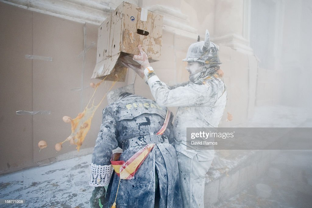 Revellers take part in the battle of 'Enfarinats', a flour fight in celebration of the Els Enfarinats festival on December 28, 2012 in Ibi, Spain. Citizens of Ibi annually celebrate the festival with a battle using flour, eggs and firecrackers. The battle takes place between two groups, a group of married men called 'Els Enfarinats' which take the control of the village for one day pronouncing a whole of ridiculous laws and fining the citizens that infringe them and a group called 'La Oposicio' which try to restore order. At the end of the day the money collected from the fines is donated to charitable causes in the village. The festival has been celebrated since 1981 after the town of Ibi recovered the tradition but the origins remain unknown.