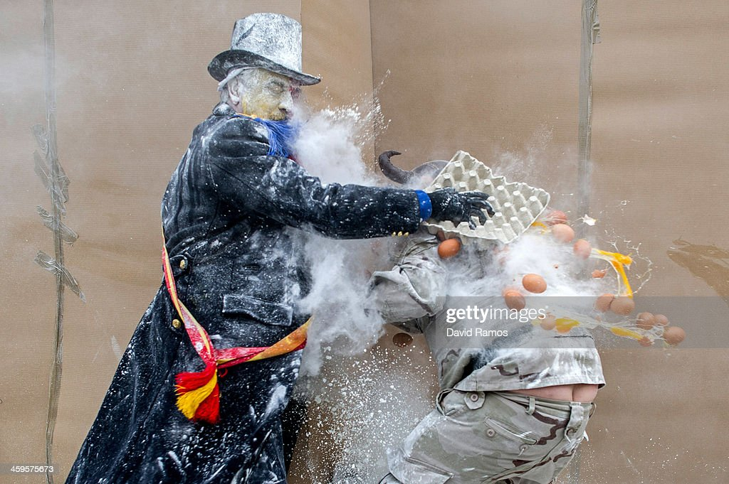Revellers take part in the battle of 'Enfarinats', a flour fight in celebration of the Els Enfarinats festival on December 28, 2013 in Ibi, Spain. Citizens of Ibi annually celebrate the festival with a battle using flour, eggs and firecrackers. The battle takes place between two groups, a group of married men called 'Els Enfarinats' which take the control of the village for one day pronouncing a whole host of ridiculous laws and fining the citizens that infringe them and then another group called 'La Oposicio' which try to restore order. At the end of the day the money collected from the fines is donated to charitable causes in the village. The festival has been celebrated since 1981 after the town of Ibi recovered the tradition but the origins remain unknown.