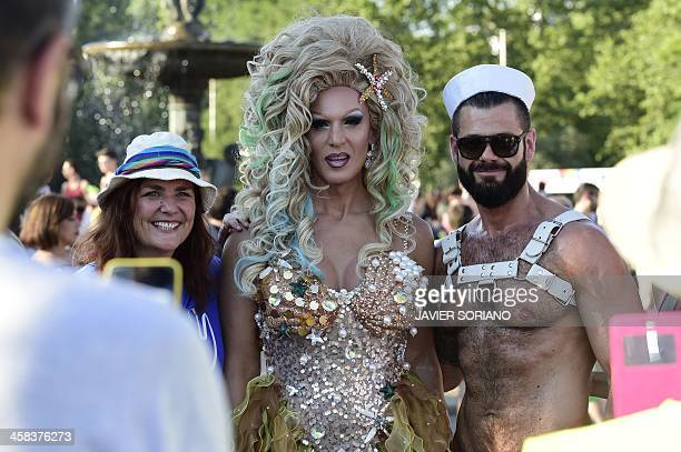 Revellers take part in the Gay Pride Parade in Madrid on July 2 2016 / AFP / Javier SORIANO
