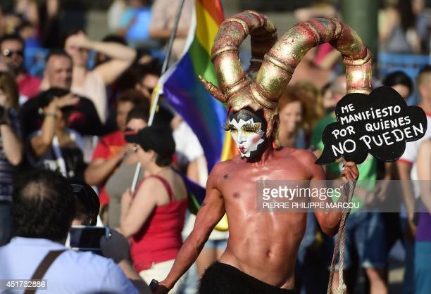 Revellers take part in the Gay Pride Parade in Madrid on July 5 2014 Crowds of revellers in elaborate costumes filled the streets of central Madrid...