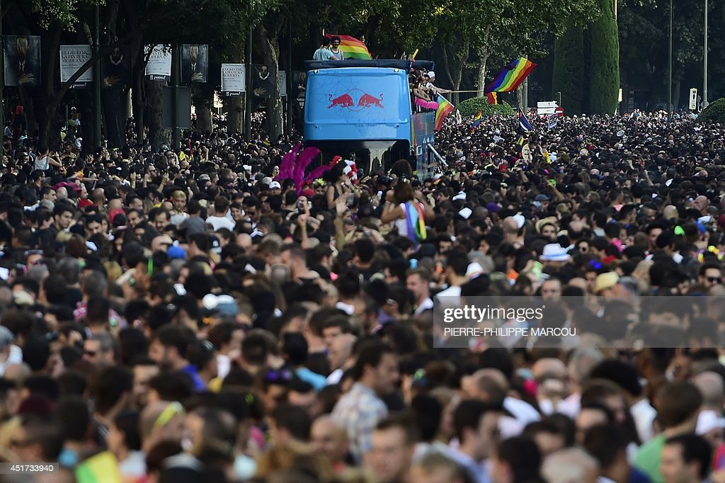 Revellers take part in the Gay Pride Parade in Madrid on July 5, 2014. Crowds of revellers in elaborate costumes filled the streets of central Madrid today in what organisers billed the biggest gay pride parade in Europe. Organisers expected more than a million people at the evening parade, the main event in five days of festivities by defenders of lesbian, gay, bisexual and transgender (LGBT) rights.