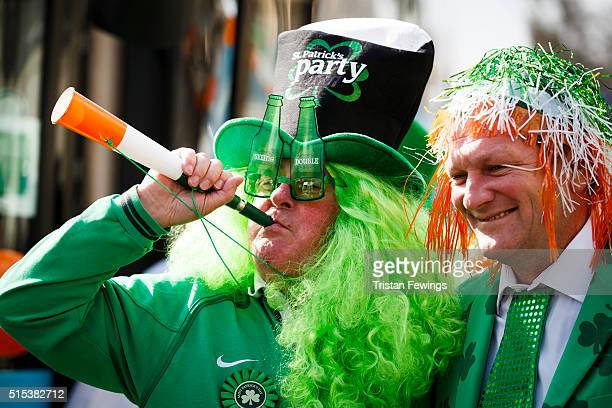 Revellers take part in the St Patrick's Day parade through central London on March 13 2016 in London England