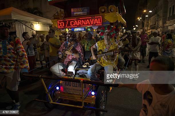 Revellers take part in the street carnival in Salvador northeastern Brazil on March 2 2014 AFP PHOTO/HIROSUKE KITAMURA