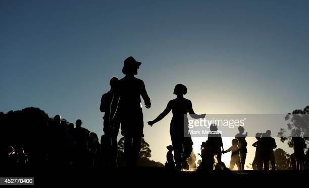 Revellers walk between stages at Splendour In the Grass 2014 on July 27 2014 in Byron Bay Australia