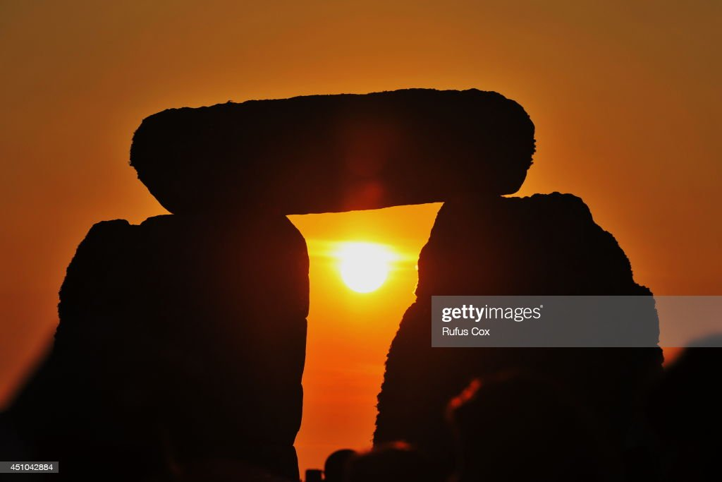 Revellers watch sunrise over Stonehenge during celebrations to mark the summer solstice at the prehistoric monument on June 21, 2014 in Wiltshire, England. An estimated 37,000 revellers and modern day druids gathered at Stonehenge, a tradition dating back thousands of years, to celebrate the solstice and watch the sunrise.