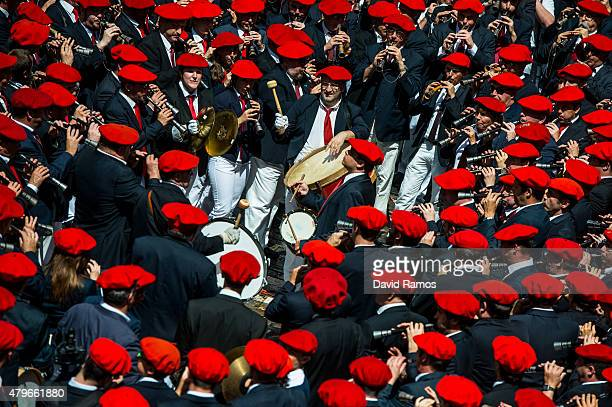 Revellers wave their arms as the band plays during the opening day or 'Chupinazo' of the San Fermin Running of the Bulls fiesta on July 6 2015 in...