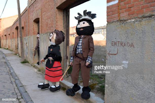 Revellers wearing costumes of 'El Zarrón' tradition pictured in the last day of carnival in Almazán north of Spain