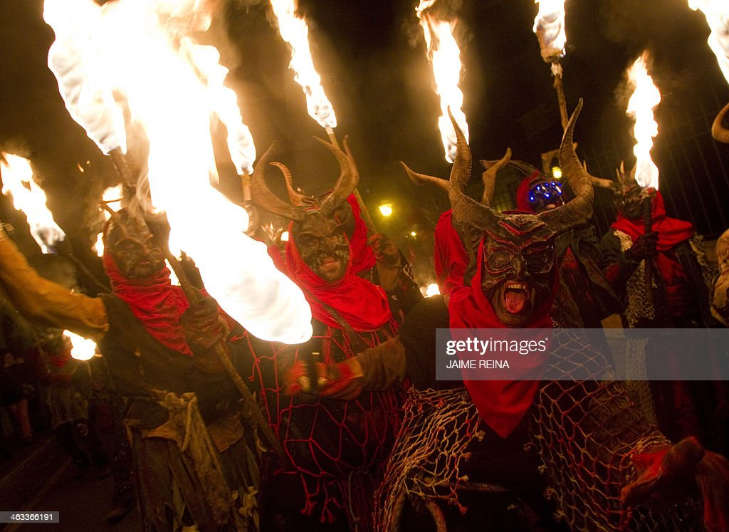 Revellers wearing demon costumes take part in the traditional festival of 'Correfoc' in Palma de Mallorca Spain on January 17 2014 Participants...