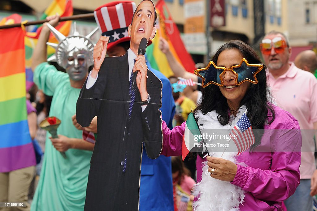 A revellers with a cutout of U.S. President <a gi-track='captionPersonalityLinkClicked' href=/galleries/search?phrase=Barack+Obama&family=editorial&specificpeople=203260 ng-click='$event.stopPropagation()'>Barack Obama</a> attends the annual Gay Pride parade on June 29, 2013 in Milan, Italy. The parade is part of a World Pride Week and attracted thousands of marchers fighting for gay rights.