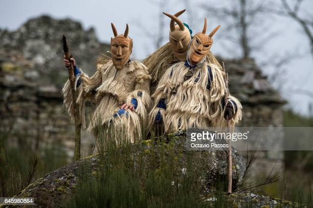 Revellers with wooden masks and carnival garb during the traditional Celtic carnival 'Caretos' in Lazarim on February 27 2017 in Lamego Portugal...