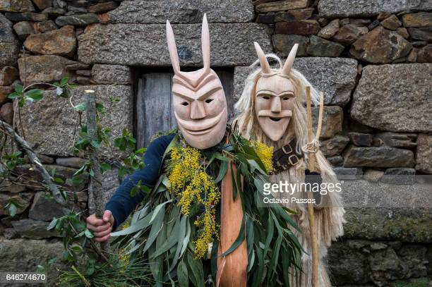 Revellers with wooden masks and carnival garb during the traditional Celtic parade carnival 'Caretos' in Lazarim on February 28 2017 in Lamego...