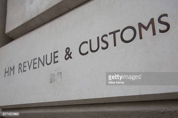 HM Revenue Customs also known as HMRC sign outside their offices in Whitehall London This organisation is in charge of all elelments of tax and...