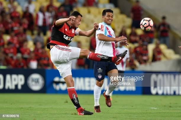 Rever of Brazil's Flamengo fights for the ball with Teofilo Gutierrez of Colombia's Junior de Barranquilla during their Copa Sudamericana first leg...
