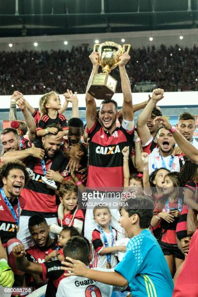 Rever of Brazil's Flamengo holds the champions cup after winning against Fluminense the Copa Carioca football match at Maracana stadium in Rio de...