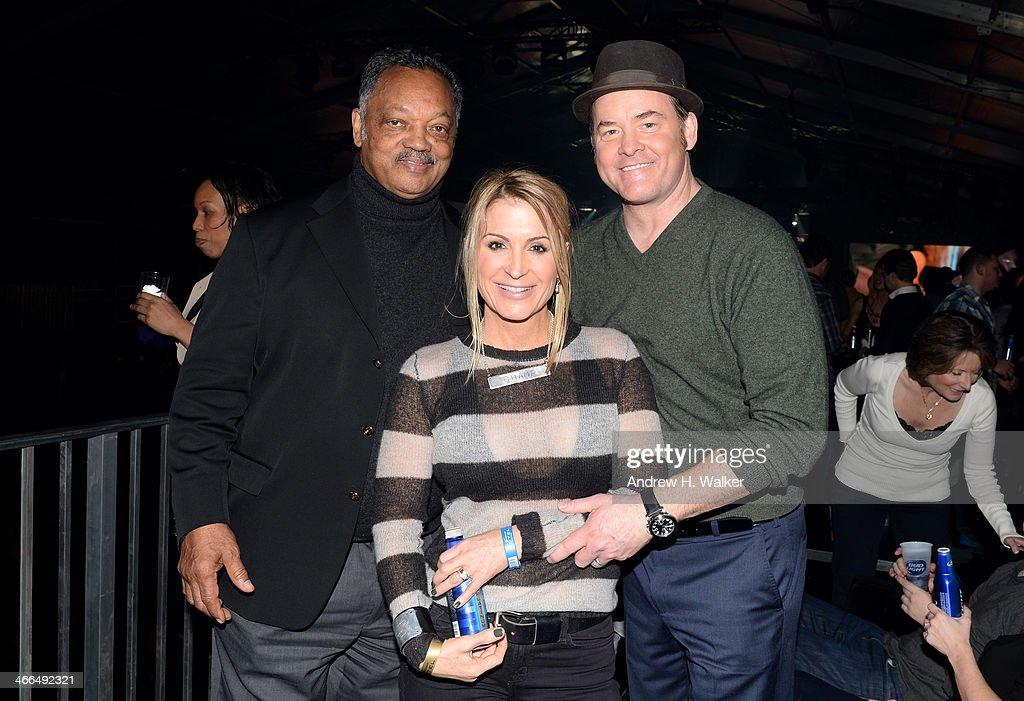 Reverand Jesse Jackson (L), Actor David Koechner (R) and Leigh Koechner attend the Bud Light Hotel on February 1, 2014 in New York City.