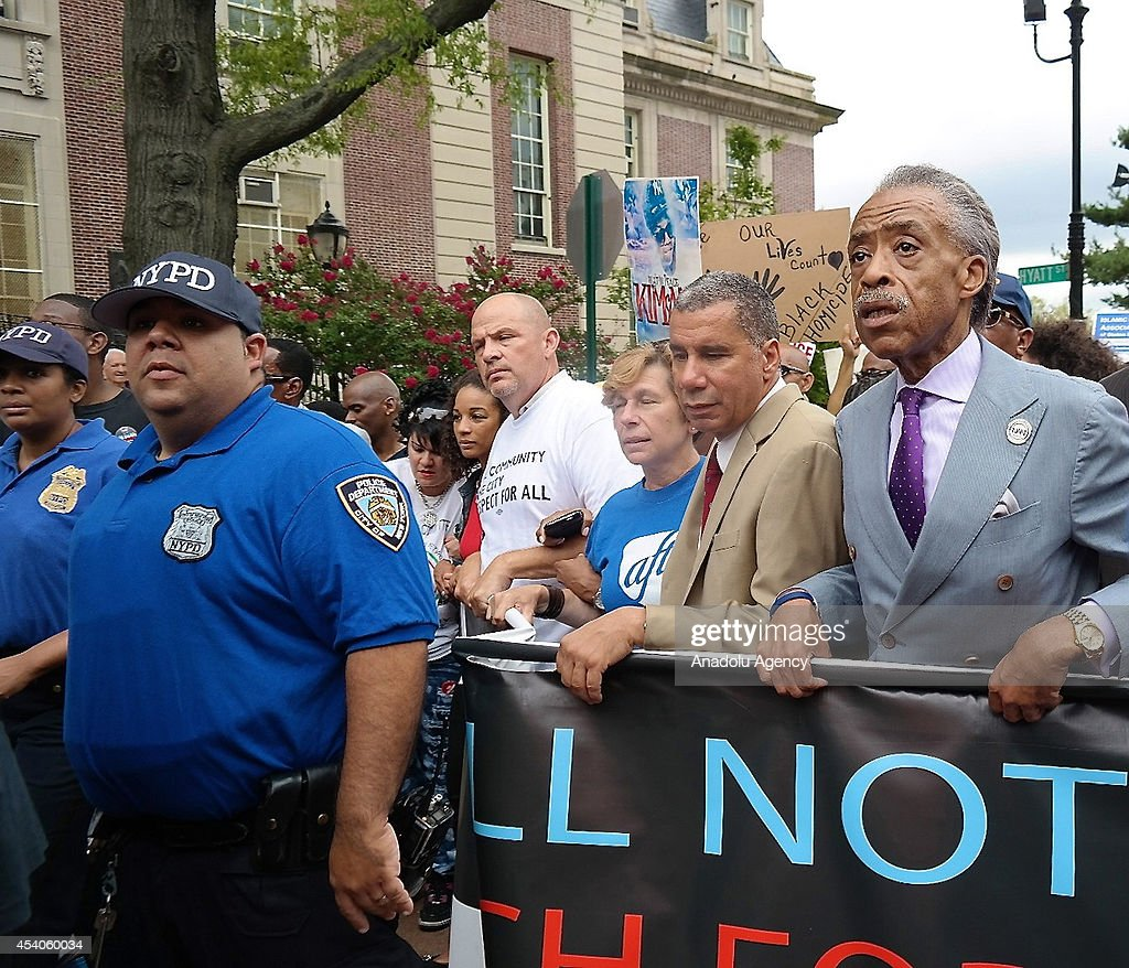 Reverend Al Sharpton (R) and Former New York governor David Paterson (R-2) gather to protest the killing of Eric Garner in New York, United States, on August 24, 2014. Garner, 43, died on July 17 as cops tried to cuff him for allegedly selling bootleg cigarettes on a Staten Island sidewalk