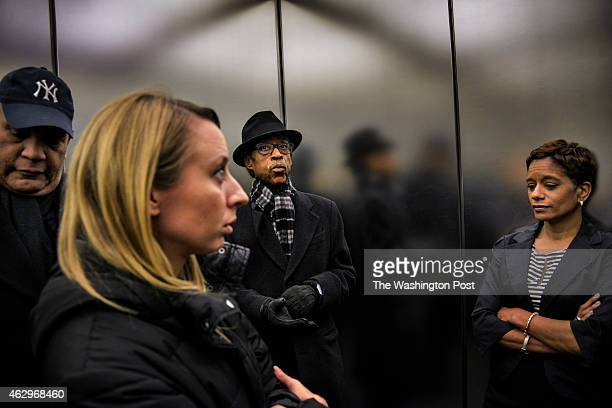 Reverend Al Sharpton C rides an elevator with Michael Hardy general counsel for NAN Jacky Johnson 2nd from L his public relations person and after a...