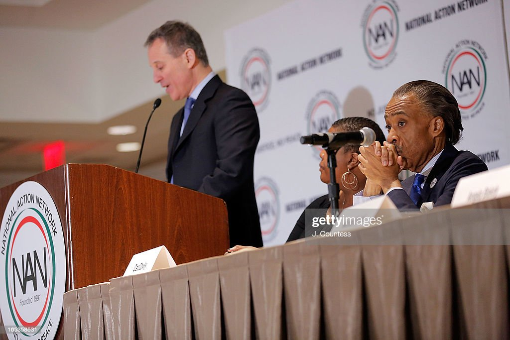 Reverend Al Sharpton (R) listens as New York State Attorney General Eric T. Schneiderman speaks prior to the panal 'Gun Violence: Addressing Real Reform' during the 2013 NAN National Convention Day 1 at New York Sheraton Hotel & Tower on April 3, 2013 in New York City.
