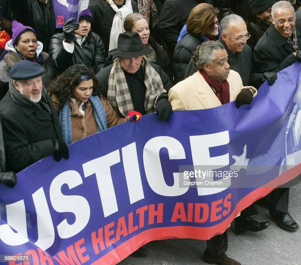 Reverend Al Sharpton marches with SEIU President Dennis Rivera and other city and union officials during a rally January 16 2006 in New York City...