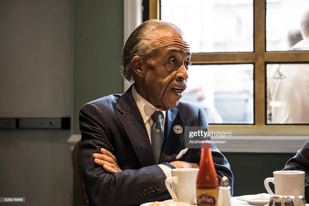 Reverend <a gi-track='captionPersonalityLinkClicked' href=/galleries/search?phrase=Al+Sharpton&family=editorial&specificpeople=202250 ng-click='$event.stopPropagation()'>Al Sharpton</a> meets with Democratic presidential candidate Sen. Bernie Sanders (D-VT) at Sylvia's Restaurant on February 10, 2016 in the Harlem neighborhood of New York City. The meeting comes after a strong victory for Senator Sanders in the New Hampshire primary.