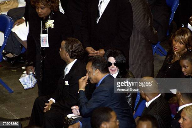 Reverend Al Sharpton Reverend Jesse Jackson and Musician Michael Jackson watch the service during a homegoing celebration for musician James Brown at...