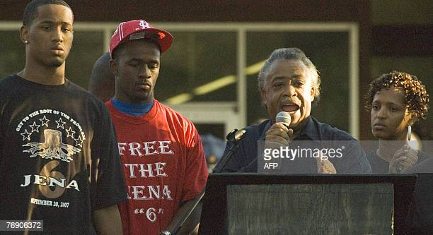 Reverend Al Sharpton speaks with two of the Jena 6 Robert Bailey Jr and Theo Shaw 20 September 2007 in front of the LaSalle Parish Courthouse in Jena...