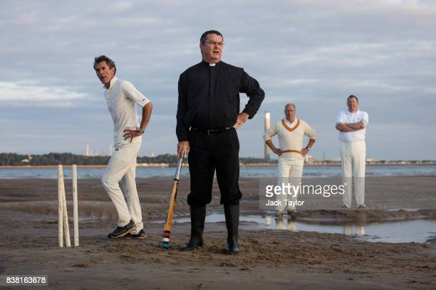 Reverend Andrew Poppe takes part in cricket match on the Brambles sandbank at low tide on August 24 2017 in Hamble England The annual event sees...