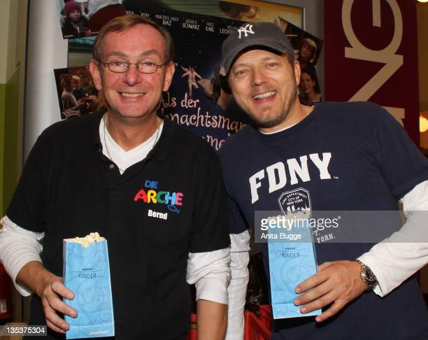 Reverend Bernd Siggelkow and comedian Mario Barth attend the 'Mario Barth Invites 200 Arche Kids To The Cinema 2011' event at the CinemaxX movie...