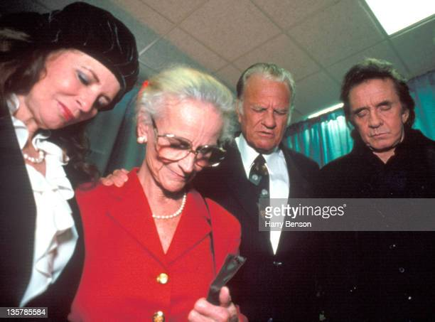 Reverend Billy Graham and wife Ruth Bell Graham are photographed with singer/songwriters Johnny Cash and June Carter Cash for Life Magazine in 1993...