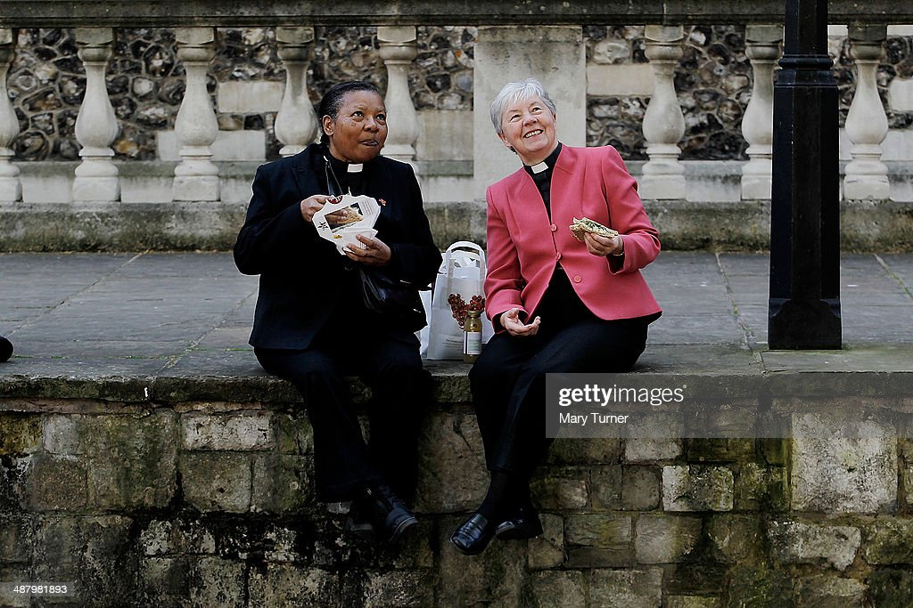 Reverend Canon Joyce Forbes from the Diocese of Southwark (L) and Rev Jennifer Williamson from the Diocese of Richmond (R) have lunch at Deans Yard, Westminster before they march with over 600 women priests to St Paul's Cathedral for a special service with the Archbishop of Canterbury, Justin Welby, to celebrate twenty years since the ordination of women priests became possible, on May 3, 2014 in London, England. The service comes ahead of a vote in July when the Church of England is expected to pass legislation that will allow the women in the church to be ordained as Bishops.