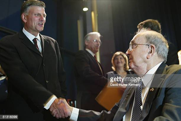Reverend Franklin Graham greets former Senator Jesse Helms at a HIV/AIDS event at the Kennedy Center on June 11 2003 in Washington DC