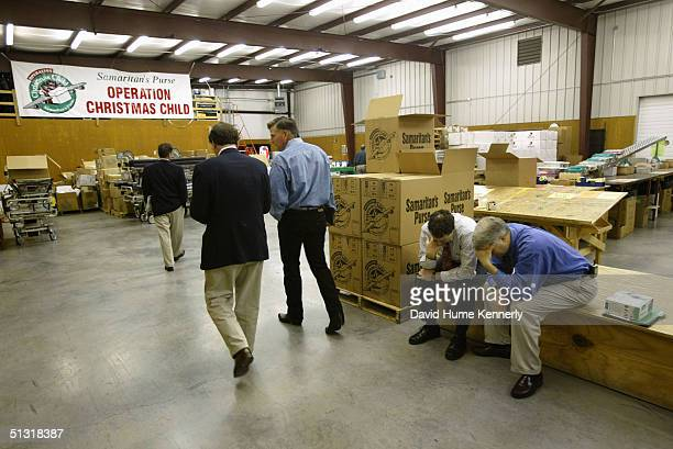 Reverend Franklin Graham walks through a warehouse at the headquarters of his organization Samaritan's Purse on June 6 2003 in Boone North Carolina...