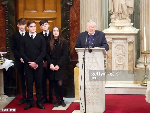 Reverend Harold Good speaks while the grandchildren of former Northern Ireland Deputy First Minister Martin McGuinness look on during his funeral in...