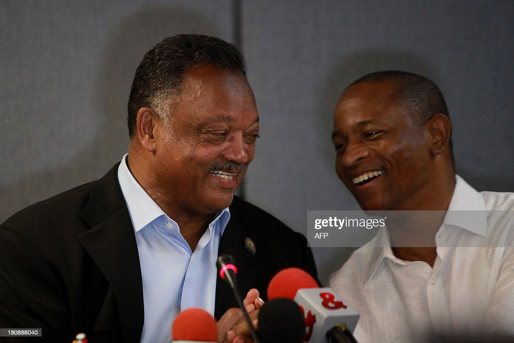 US reverend Jesse Jackson (L) and the director of the Third World Summit of Mayors and Governors of African descent, Esaud Urrutia, laugh during a press conference, during the second part of the summit, at the Julio Cesar Turbay Convention Centre in Cartagena, Colombia, on September 17, 2013. AFP PHOTO/Joaquin Sarmiento