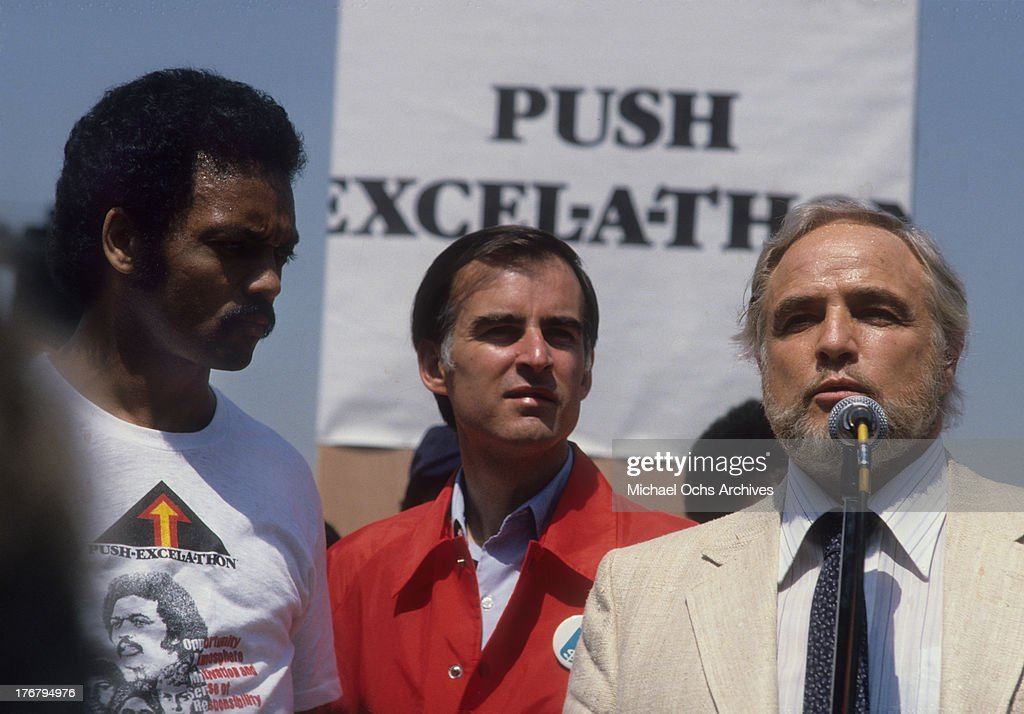 Reverend Jesse Jackson, California governor Jerry Brown and actor Marlon Brando (right) on stage at Dodger Stadium for an event to raise money Jesse Jackson's Rainbow PUSH (People United to Save Humanity) Coalition on April 23, 1979.