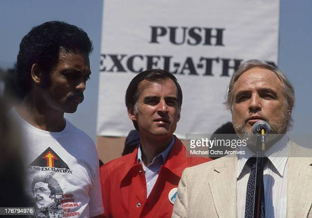 Reverend Jesse Jackson California governor Jerry Brown and actor Marlon Brando on stage at Dodger Stadium for an event to raise money Jesse Jackson's...
