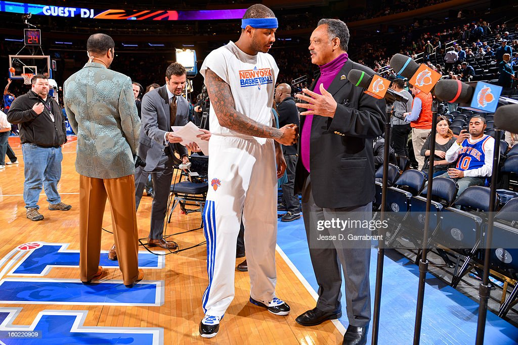 Reverend Jesse Jackson greets Carmelo Anthony #7 of the New York Knicks before a game between the Atlanta Hawks and Knicks at Madison Square Garden on January 27, 2013 in New York, New York.